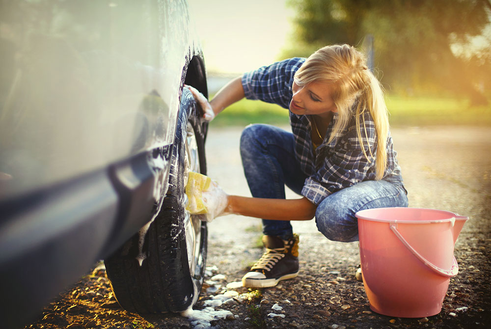 woman washing car