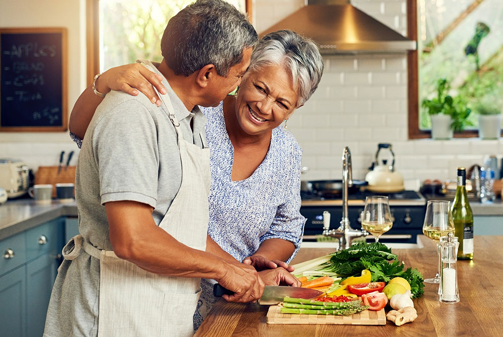 older couple preparing dinner